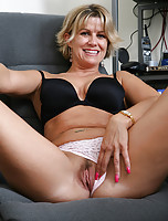 Mature secretary peels off her clothes and spread on the desk