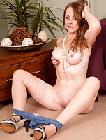 Horny milf Sofia Rae teases her nipples and spreads her long legs