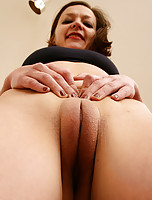Mature and petite Camilla spreads her sexy shaven pussy for you