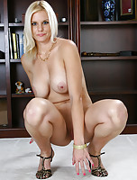 Elegant blonde MILF Slovanna slips off her dress to show off her tits