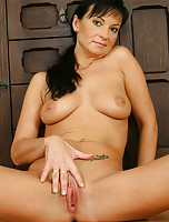 Gorgeous brunette MILF spreads her legs just for you guys